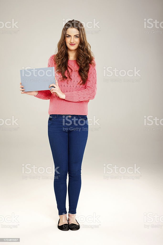 Attractive young woman holding blank billboard royalty-free stock photo