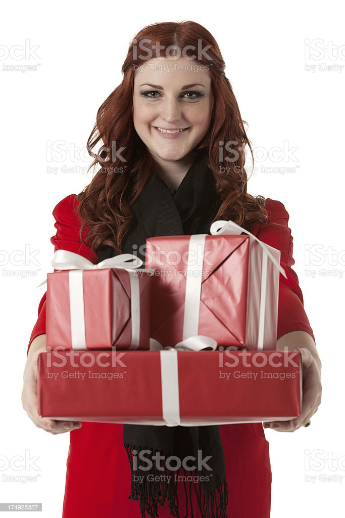 Attractive young woman holding Christmas presents royalty-free stock photo