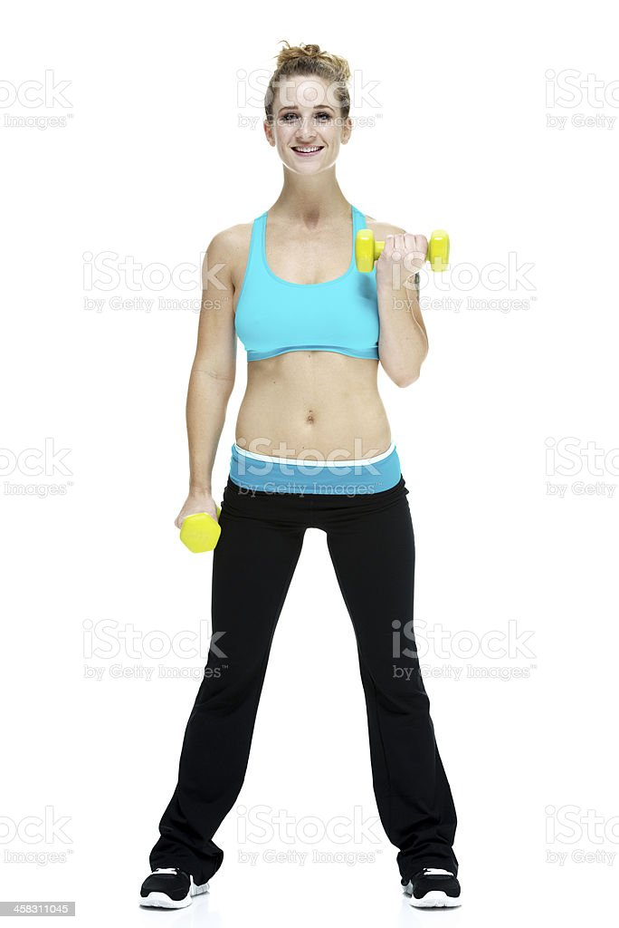 Attractive young woman holding dumbbells stock photo