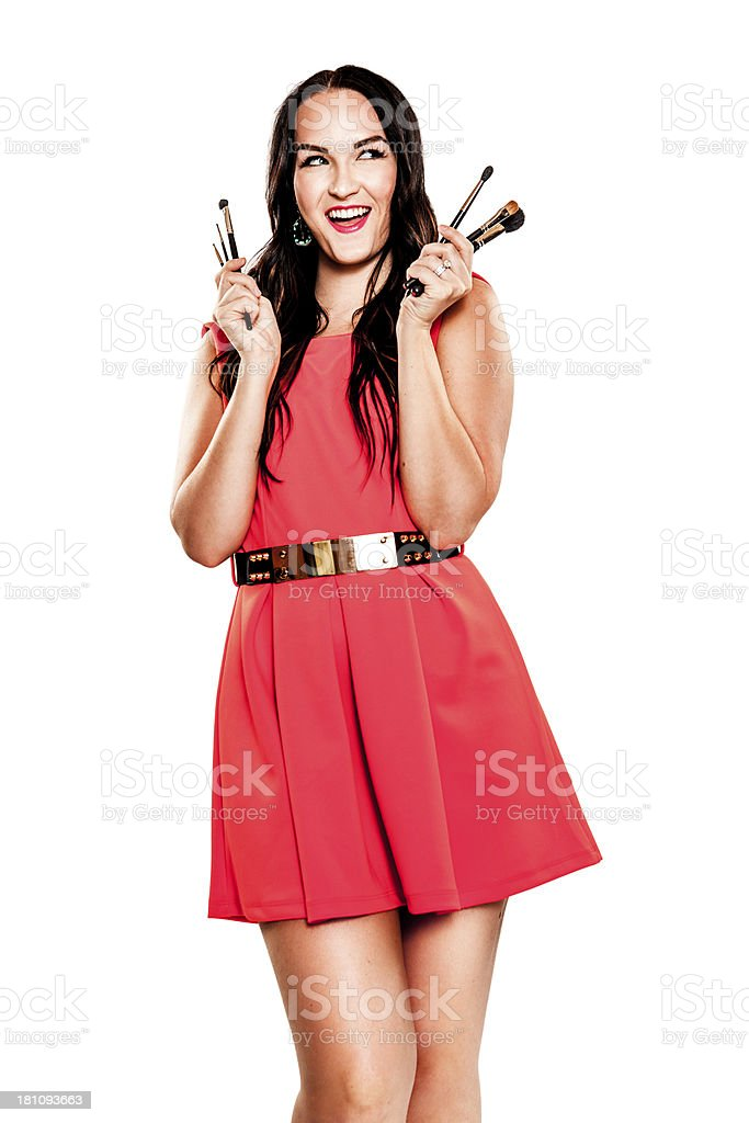 Attractive Young Woman Holding Makeup Brushes royalty-free stock photo