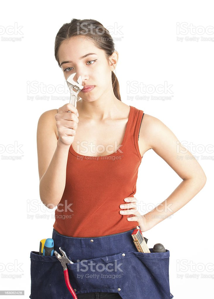 Attractive young woman holding monkey wrench royalty-free stock photo