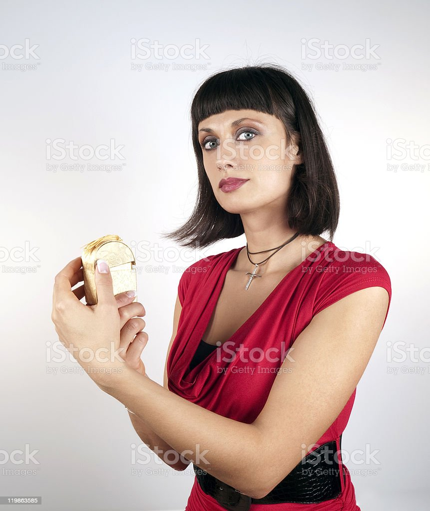 Attractive Young Woman Holding Precious Gift royalty-free stock photo