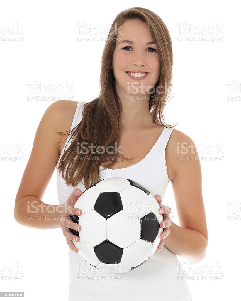 Attractive young woman holding soccer ball royalty-free stock photo