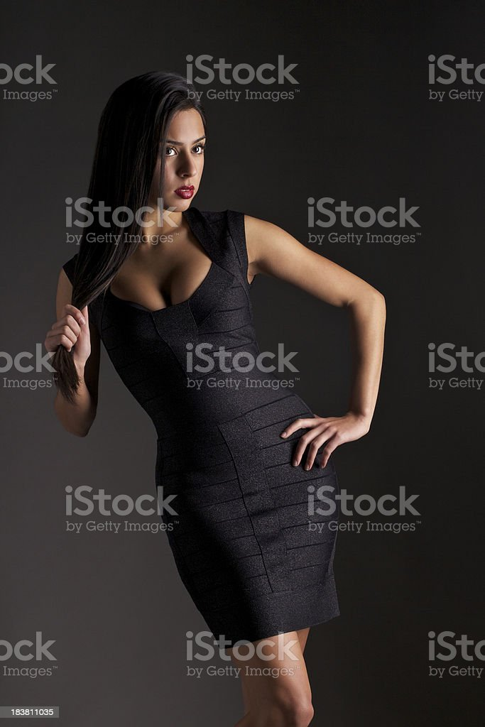 Attractive Young Woman in a Tight Dress royalty-free stock photo