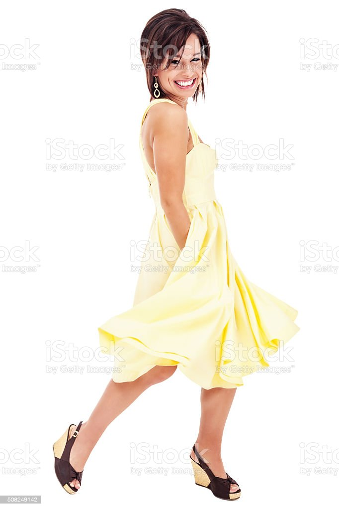 Attractive Young Woman in Bright Yellow Sun Dress stock photo