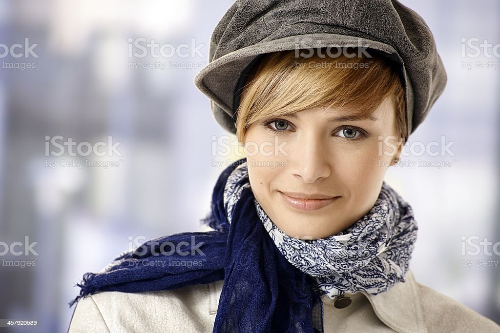 Attractive young woman in cap stock photo