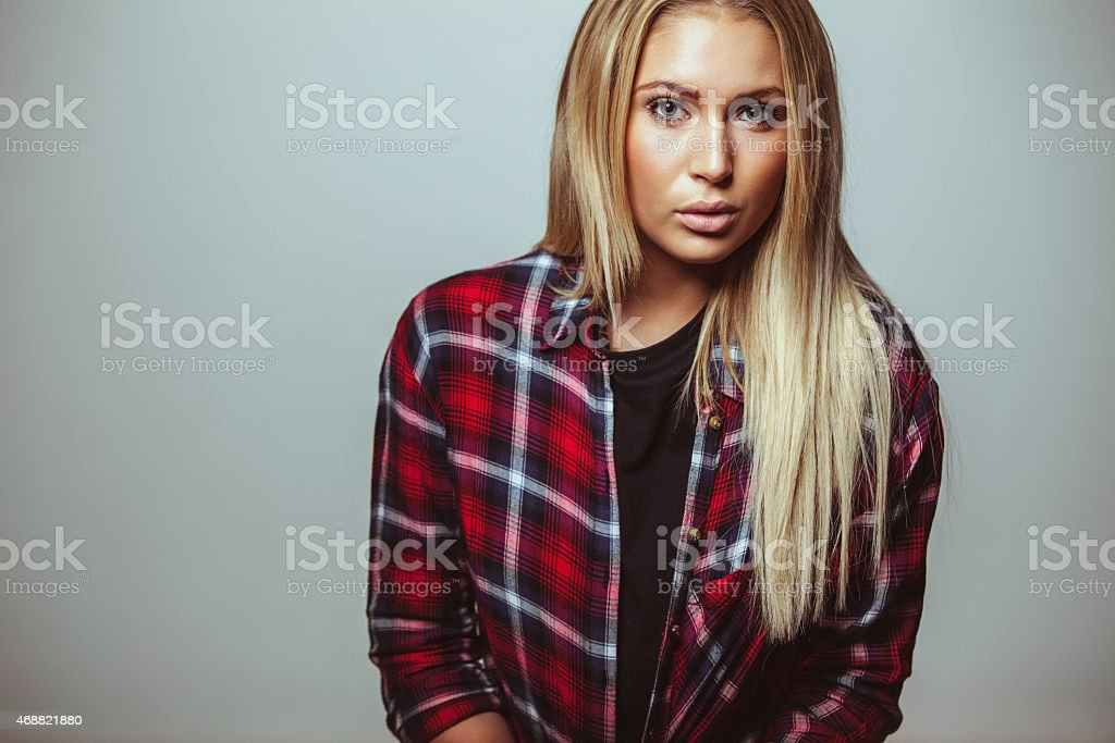 Attractive young woman in casual outfit stock photo