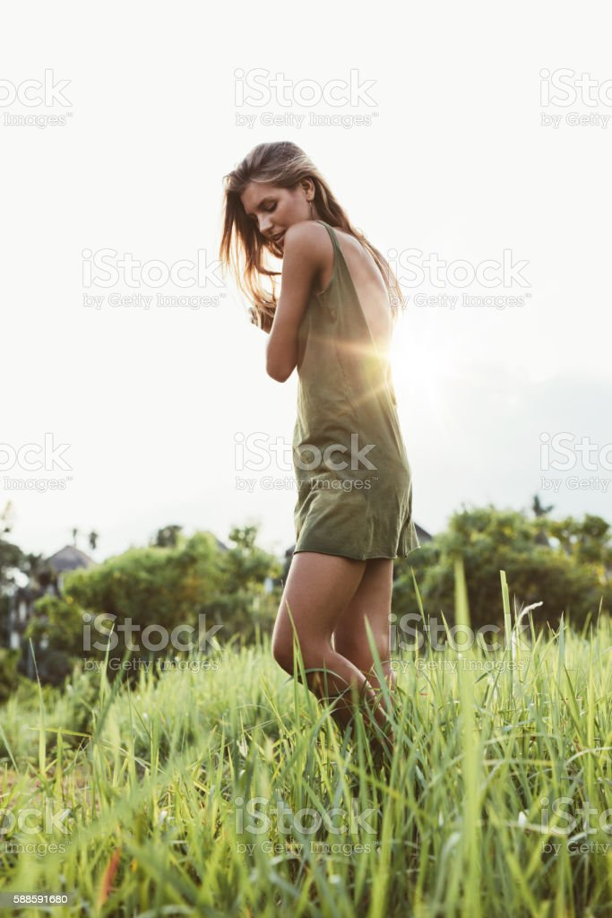 Attractive young woman in field stock photo