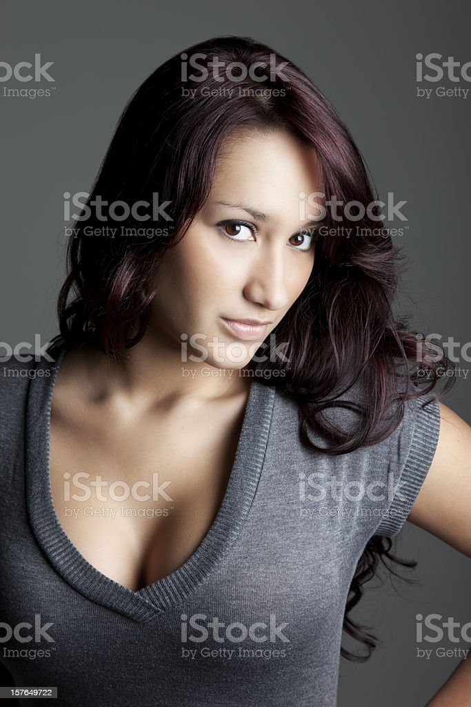 Attractive Young Woman in Gray Sweater stock photo