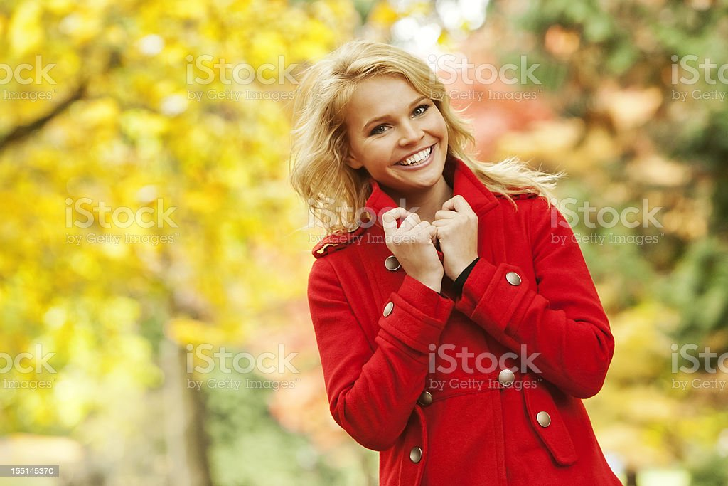 Attractive Young Woman in Red Fall Fashion Coat royalty-free stock photo