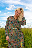 Attractive young woman in rye field