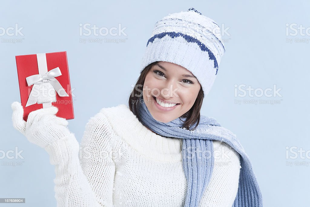 Attractive Young Woman in Sweater with Red Gift Box royalty-free stock photo