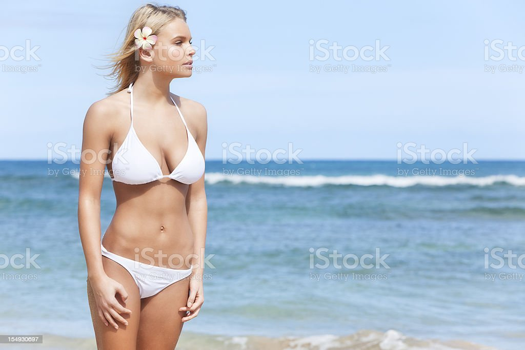 Attractive Young Woman in White Bikini on Hawaiian Beach royalty-free stock photo