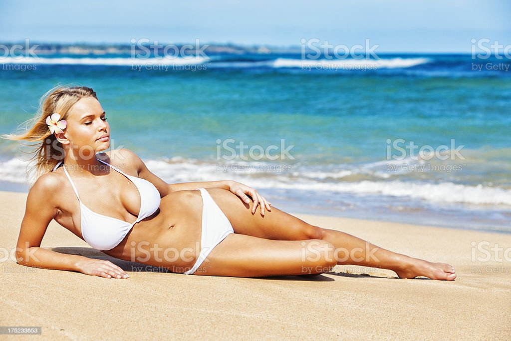 Attractive Young Woman in White Bikini on Hawaiian Beach royalty-free stock photo
