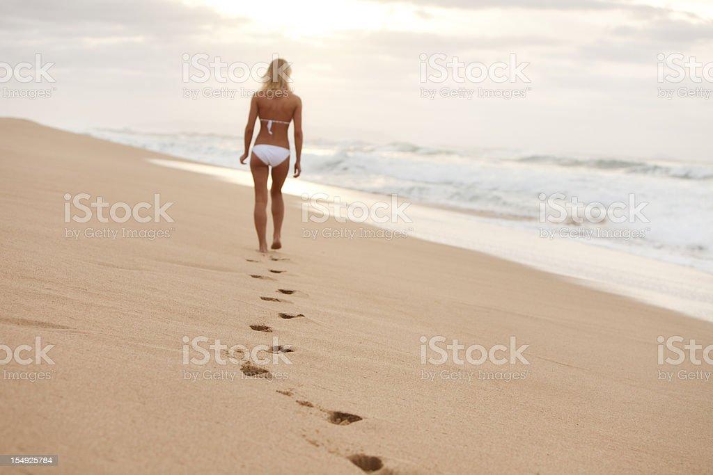 Attractive Young Woman in White Bikini Walking on Hawaiian Beach royalty-free stock photo