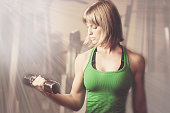 attractive young woman is engaged in fitness club working out