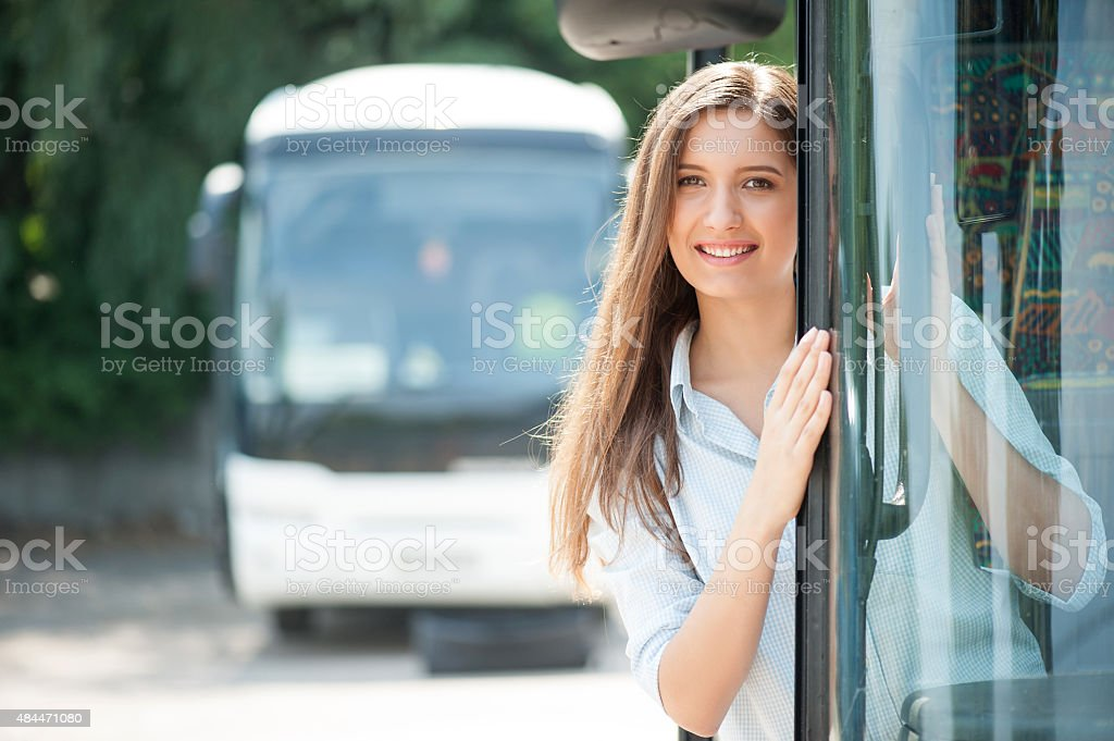 Attractive young woman is traveling in public transport stock photo