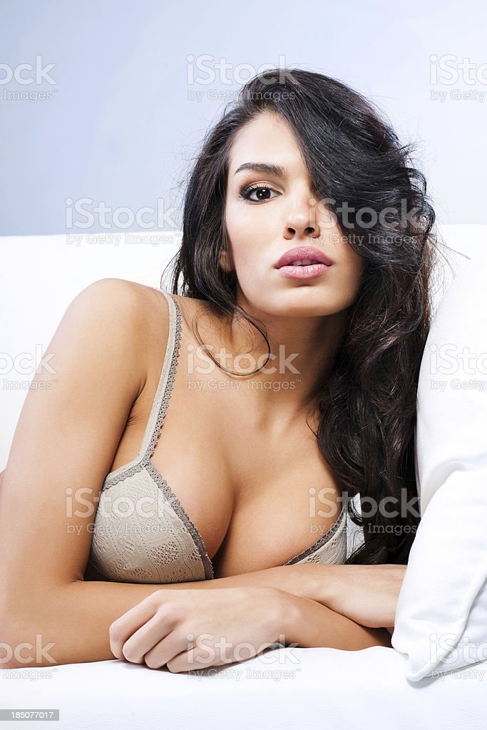 Attractive young woman leaning  on a sofa. royalty-free stock photo