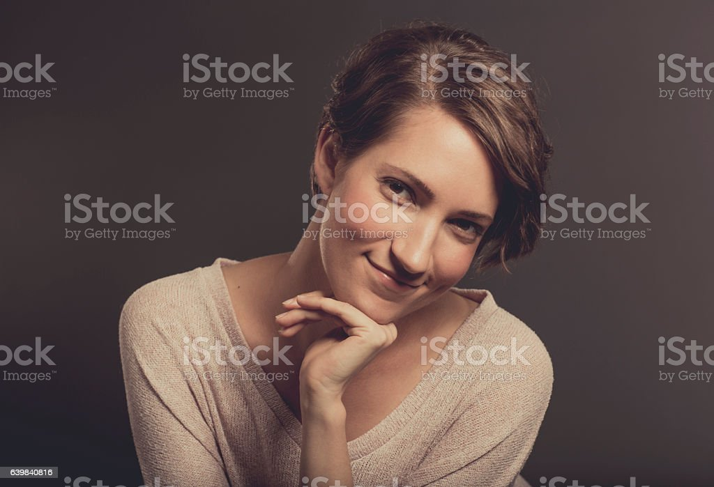 Attractive Young Woman Looking at the Camera stock photo