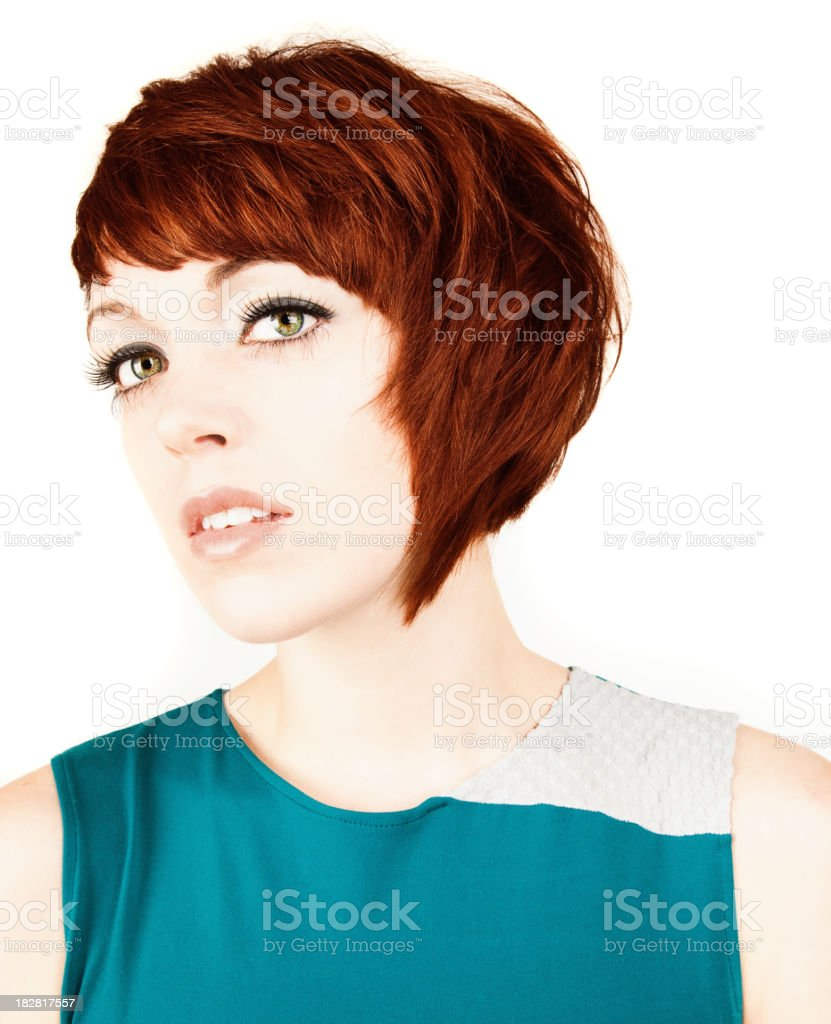 Attractive Young Woman Looks at Camera. White Background. royalty-free stock photo