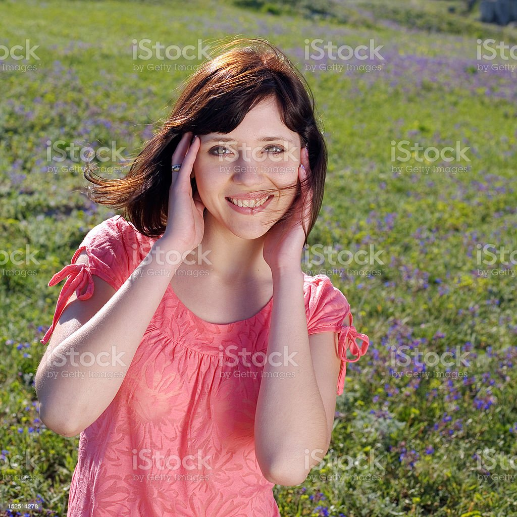 Attractive young woman on background of the field royalty-free stock photo