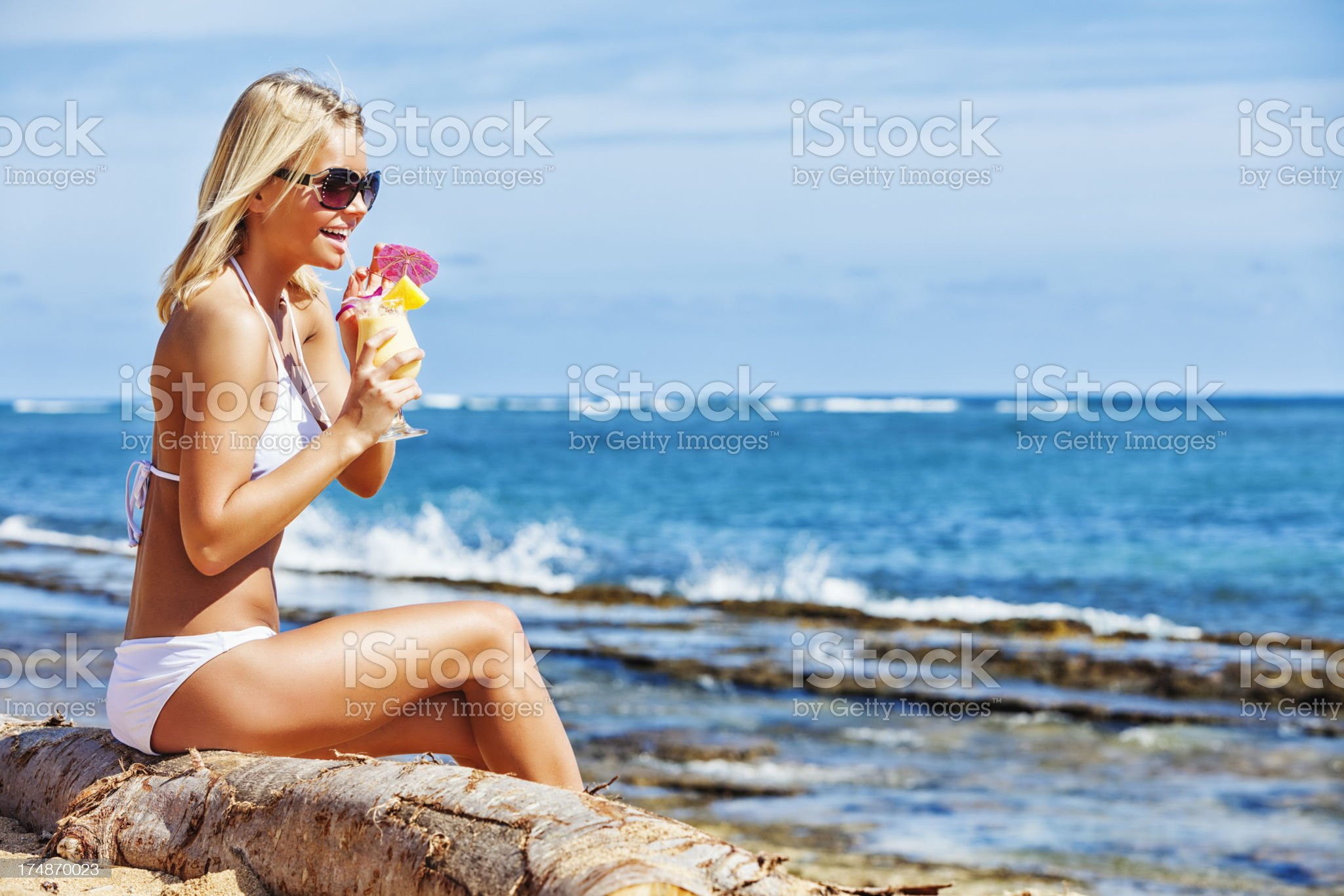 Attractive Young Woman on Beach with Tropical Refreshment royalty-free stock photo
