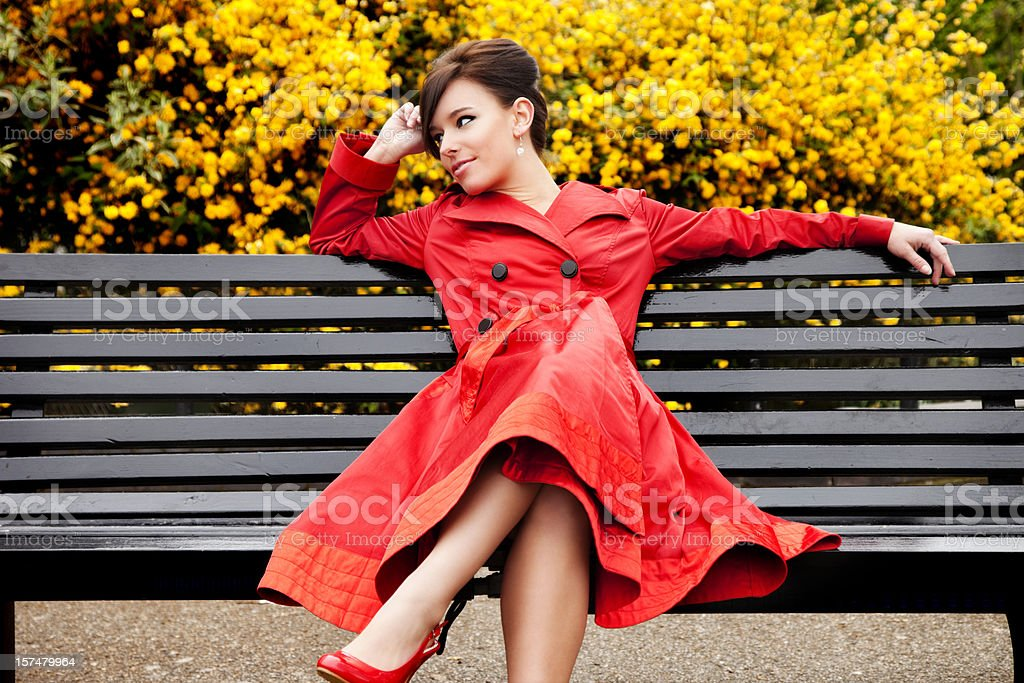 Attractive Young Woman on Park Bench royalty-free stock photo