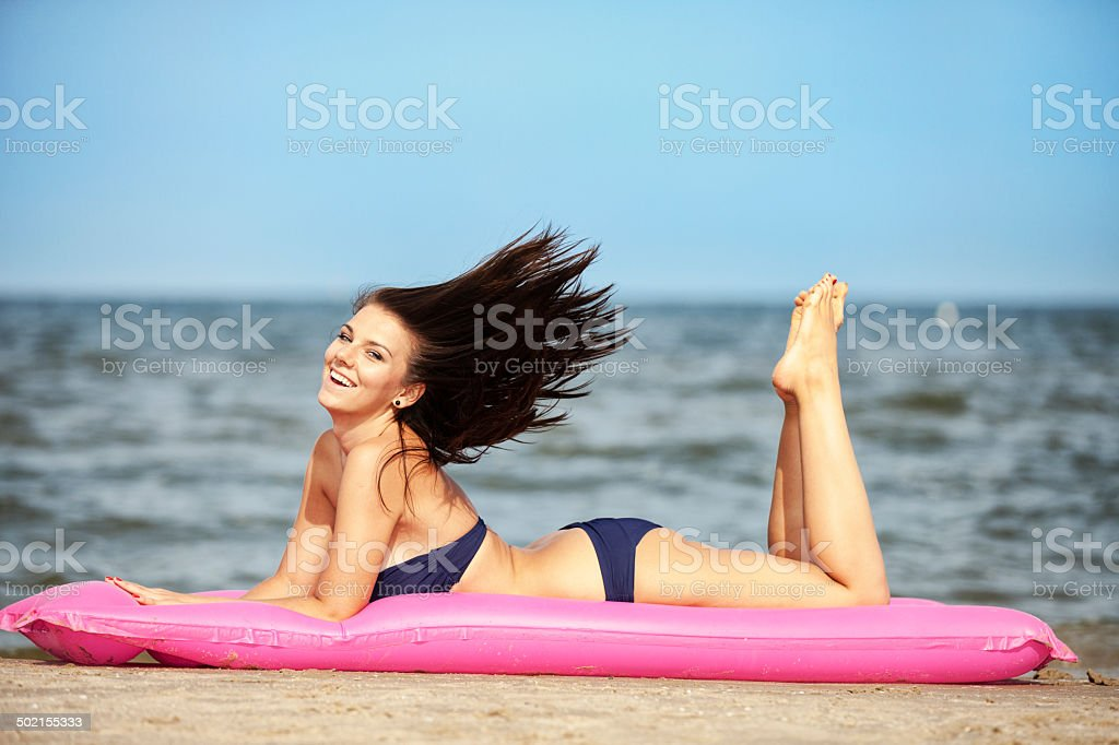 Attractive Young Woman On Pool Raft royalty-free stock photo