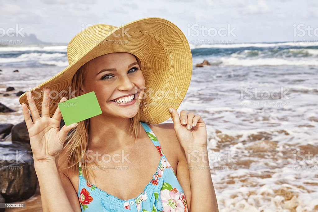 Attractive Young Woman on Vacation with Blank Credit Card stock photo