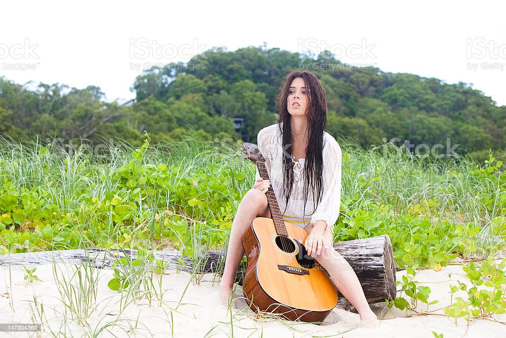Attractive Young Woman Outdoors With Guitar royalty-free stock photo
