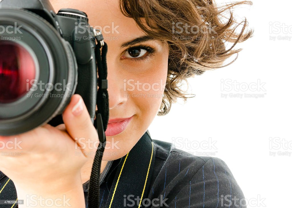 Attractive young woman photographer stock photo