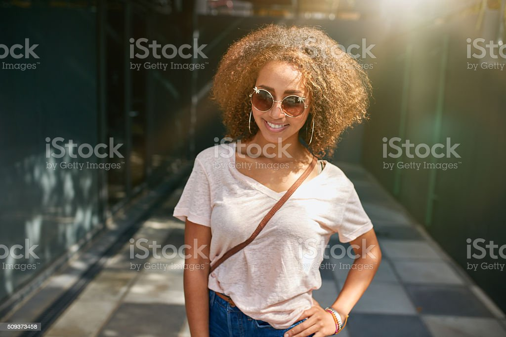 Attractive young woman posing outdoors stock photo
