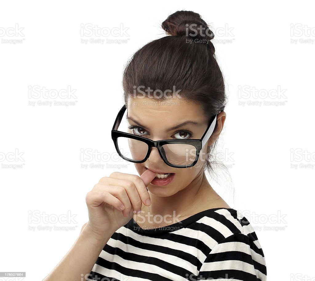 Attractive young woman pulls down here eye glasses royalty-free stock photo