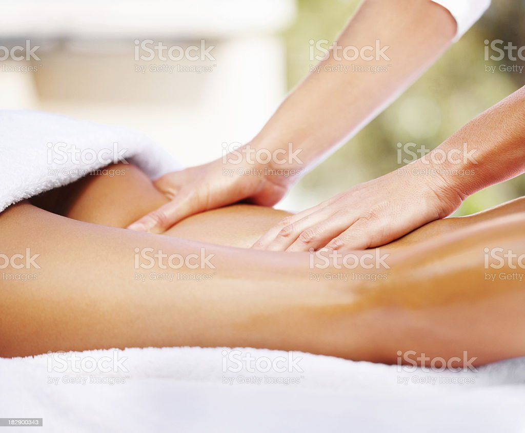 Attractive young woman receiving massage at dayspa stock photo