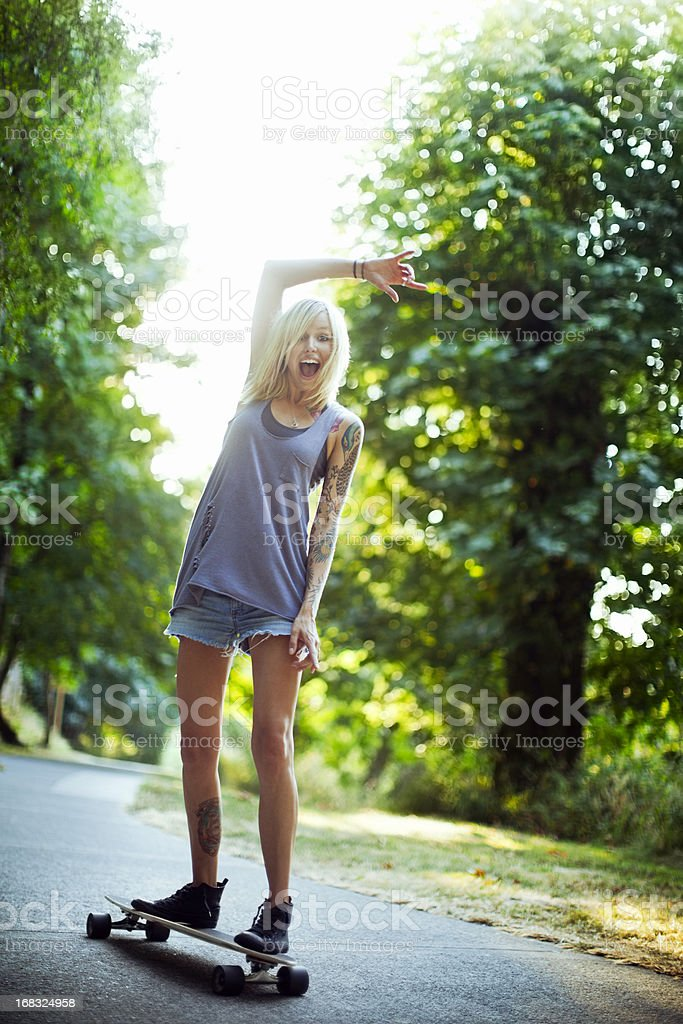 Attractive Young Woman Riding Longboard royalty-free stock photo