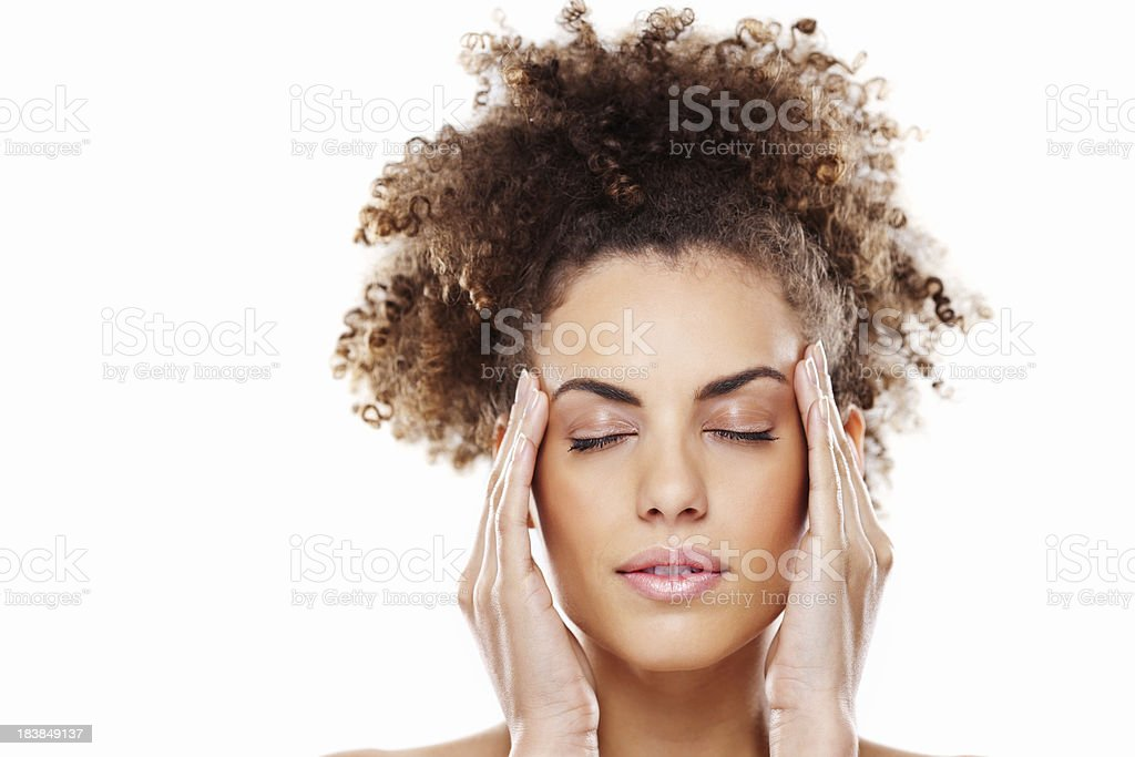 Attractive Young Woman Rubbing Her Temples stock photo