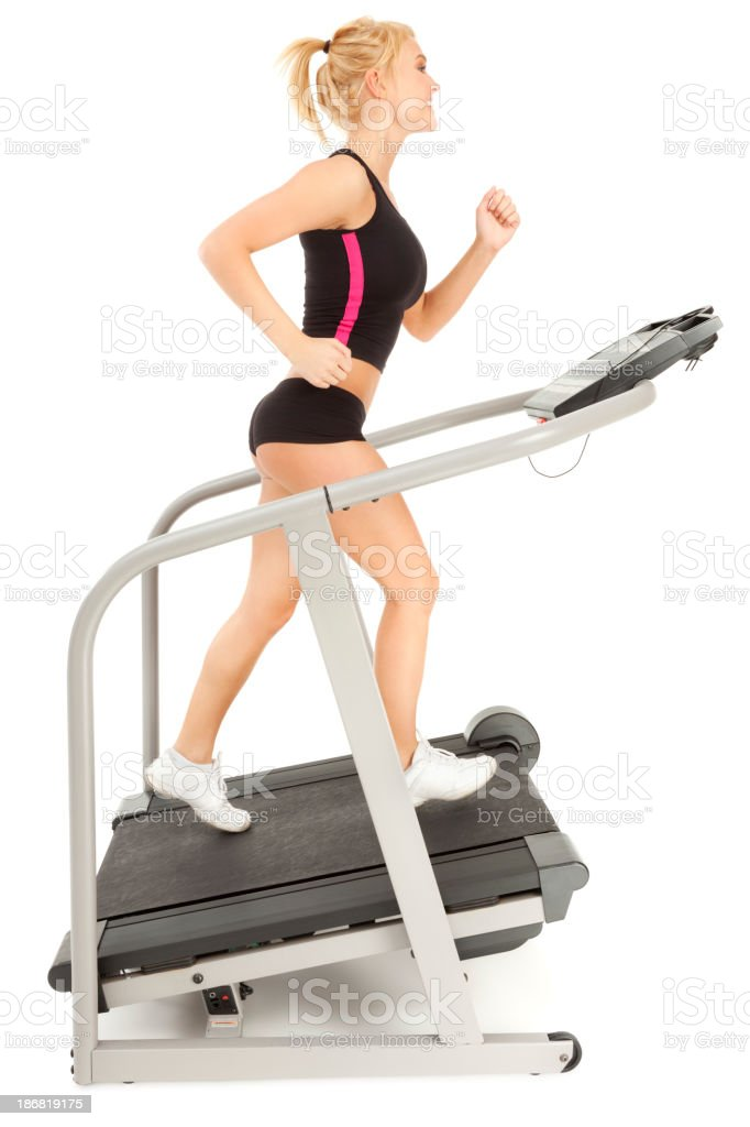 Attractive Young Woman Running Happily on Treadmill royalty-free stock photo
