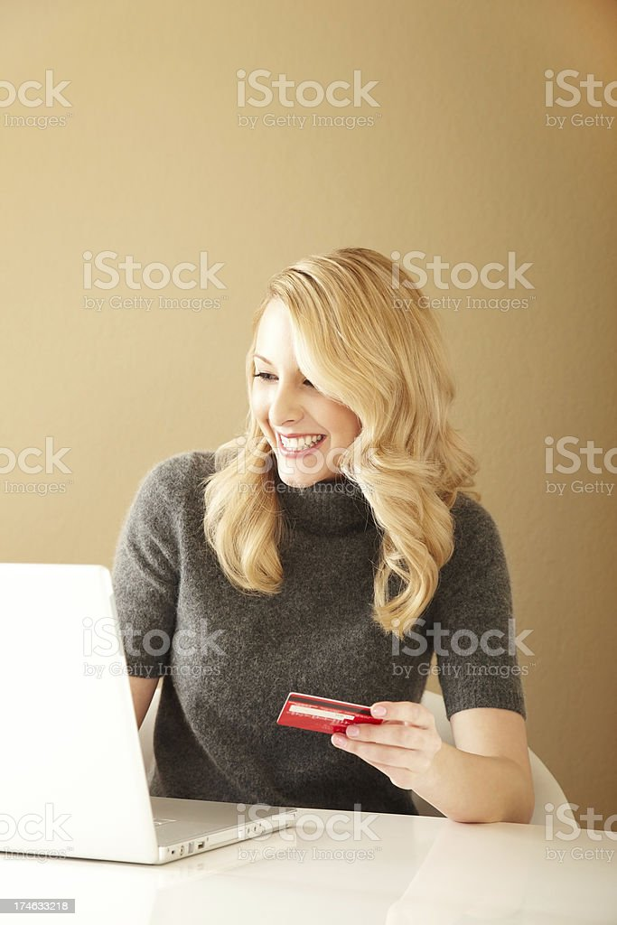 Attractive Young Woman Shopping Online at computer royalty-free stock photo