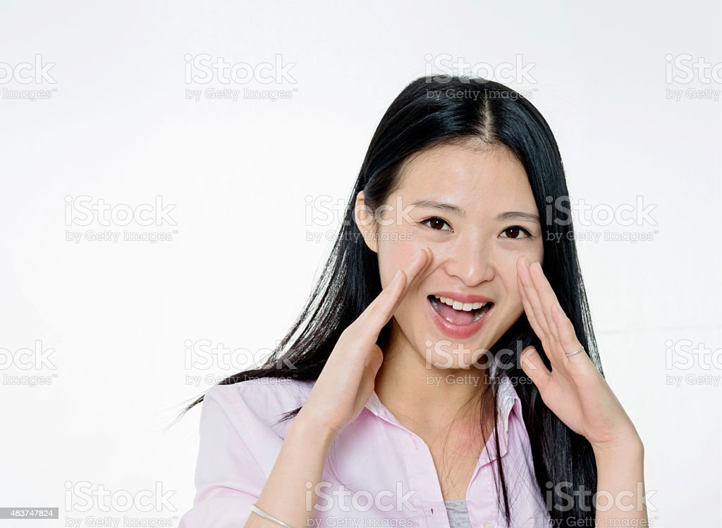Attractive young woman shouting stock photo