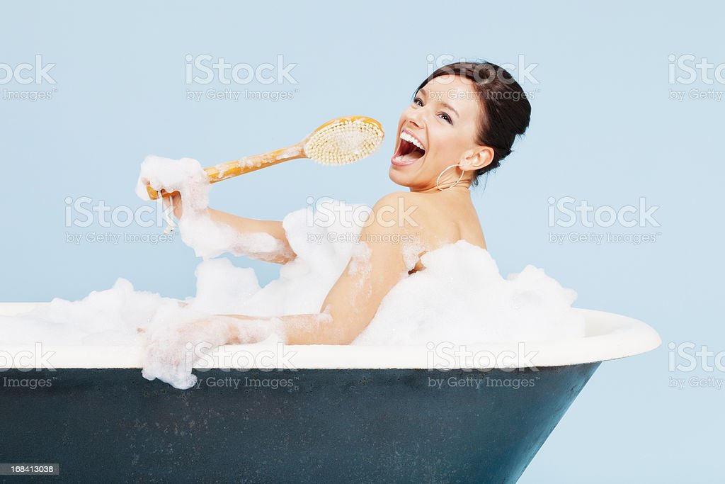 Attractive Young Woman Singing in Bath Tub royalty-free stock photo