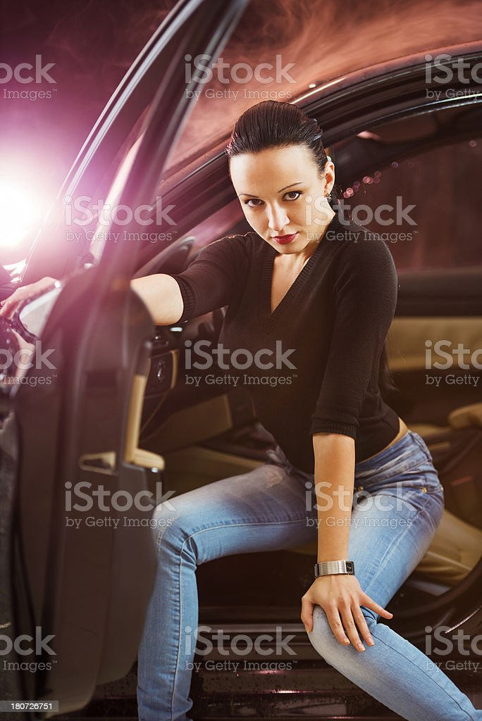 Attractive young woman sitting in luxurious car. royalty-free stock photo