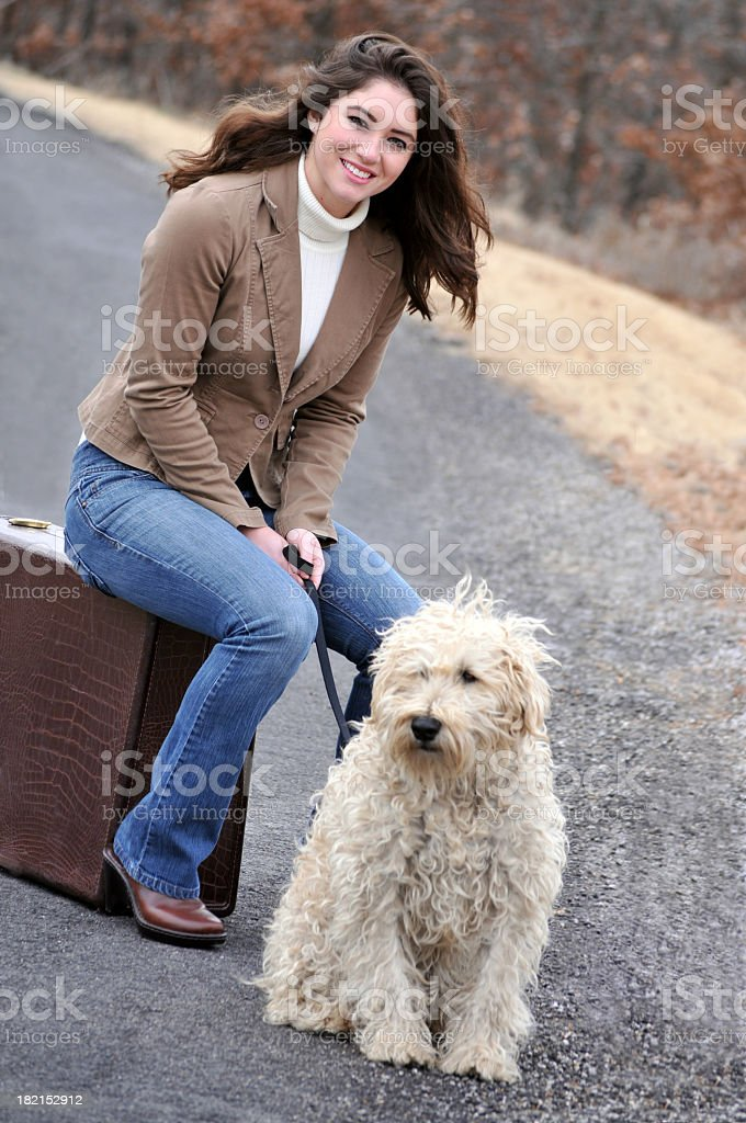 Attractive Young Woman Sitting with her Wheaten Terrier stock photo
