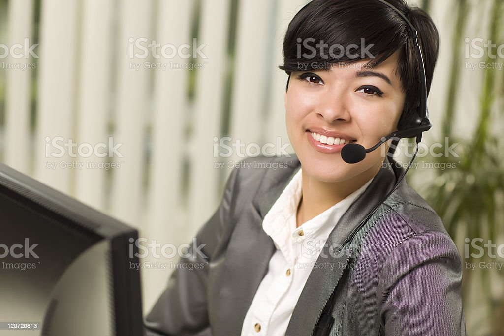 Attractive Young Woman Smiles Wearing Headset royalty-free stock photo