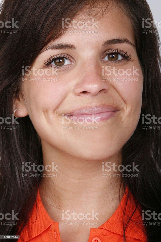Attractive young woman smiling at camera royalty-free stock photo