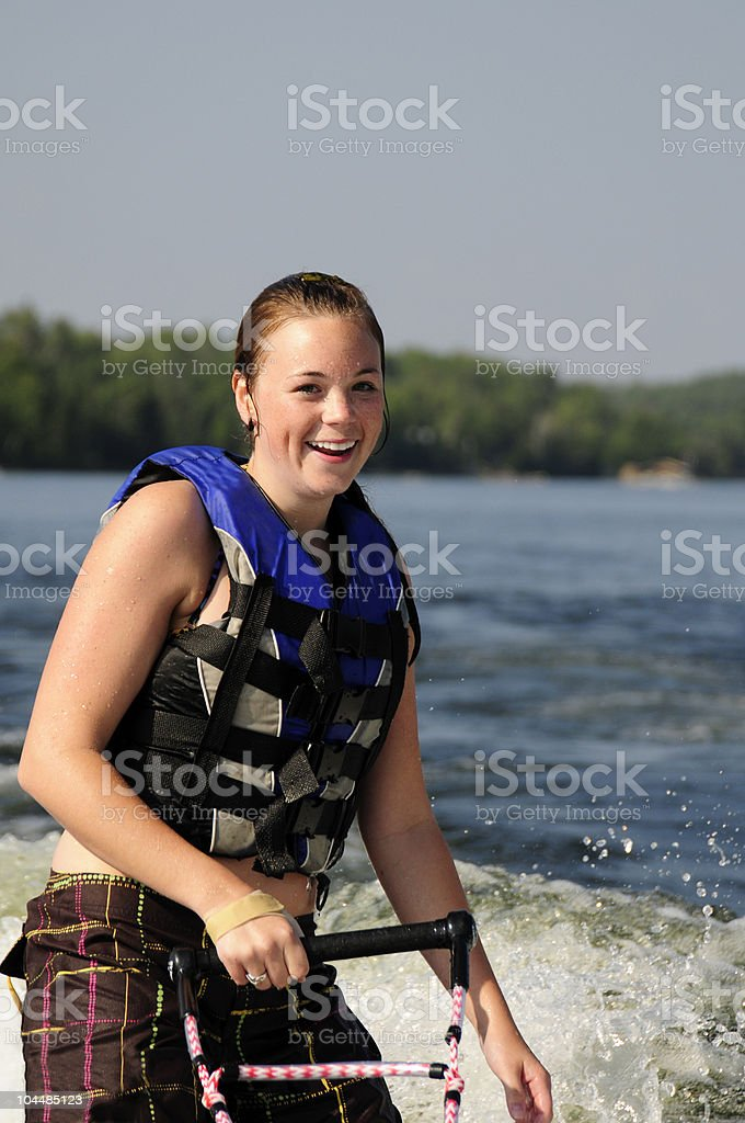 Attractive young woman smiling at the lake. stock photo