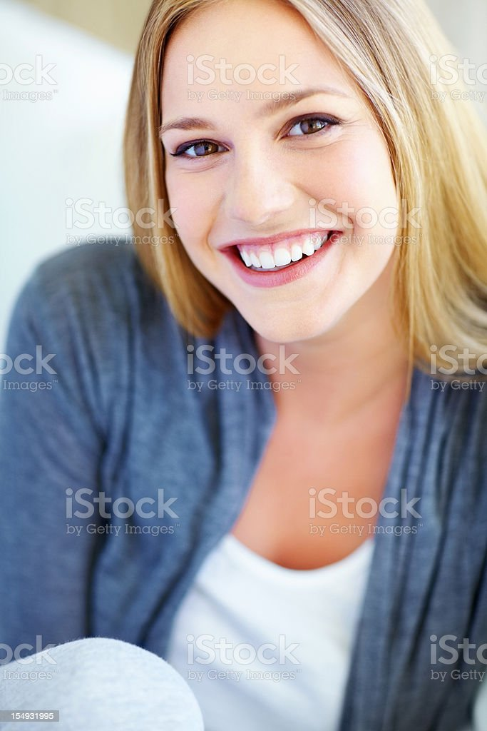 Attractive young woman smiling at you royalty-free stock photo