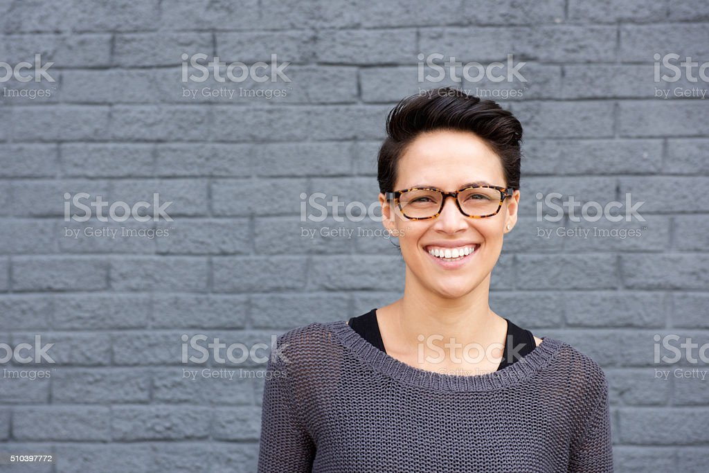 Attractive young woman smiling with glasses stock photo