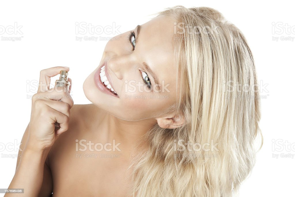 Attractive Young Woman Spraying Self with Perfume royalty-free stock photo