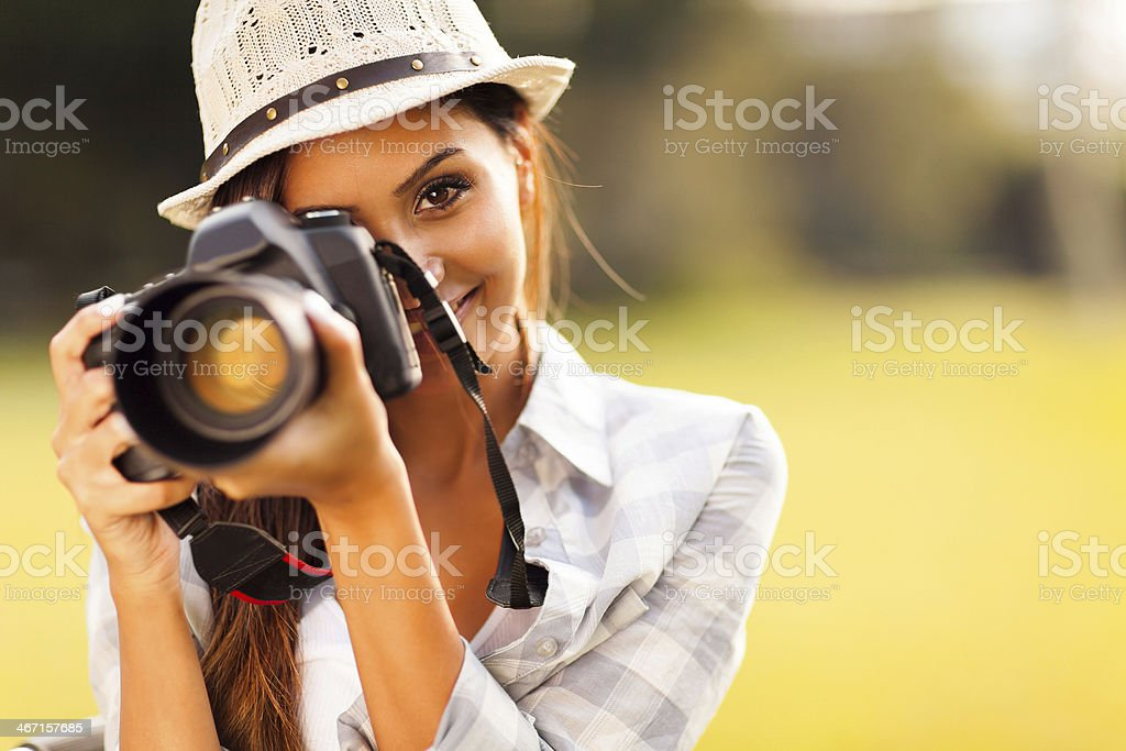 attractive young woman taking pictures stock photo