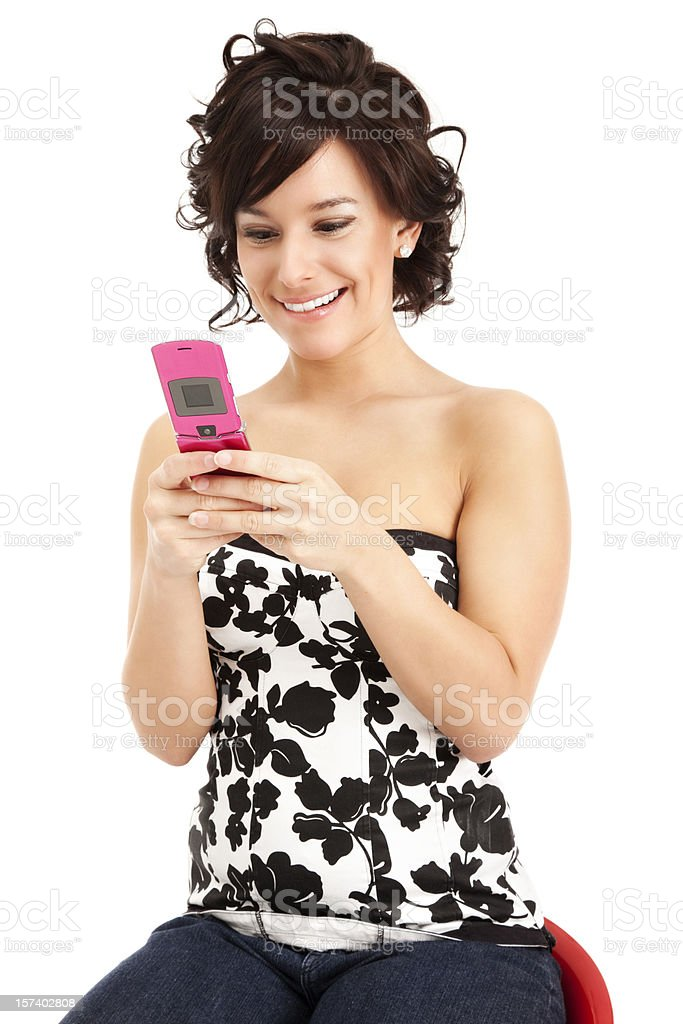 Attractive Young Woman Texting with Flip Phone royalty-free stock photo
